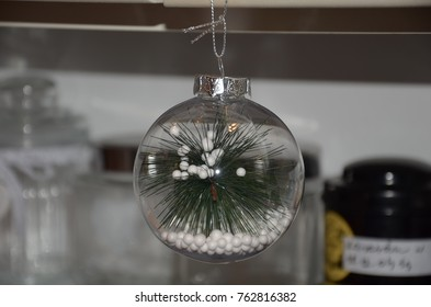 Christmas and New Year tree decoration hanging on the blurred kitchen background