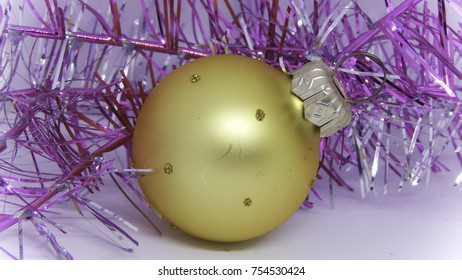 Christmas and New Year tree decorations, yellow ball with sparkling lights on white background