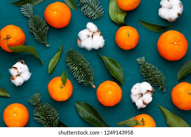 Christmas, New Year winter bright wooden pattern with tangerines and cotton plants. Top view holiday card