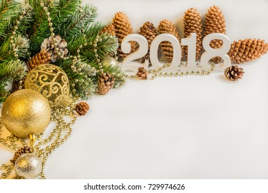 Christmas and New Year's background. A branch of a Christmas fir-tree with garlands, gifts, spheres, toys and decorating for a Christmas tree.new year 2018