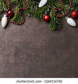 Christmas and new year's background with Christmas brunch and Christmas toys at wooden background. Horizontal template. decoration item and copy space