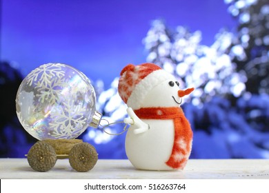 Christmas and New Year`s background with Snowman drags a car on snow forest bokeh. Foreground ready for product montage. Copyspace for sale price and item description. Concept market banner, poster.