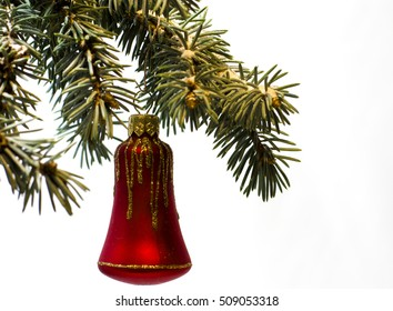 Christmas and New Year`s bokeh image. Red bell toy decorations on tree branches.  Isolated on white background. Greeting card concept with holiday tinsel and copyspace place for text or logo.