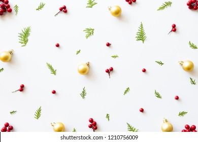 Christmas and New Year's composition. Top view of spruce branches, pine cones, red berries and bell on white background.