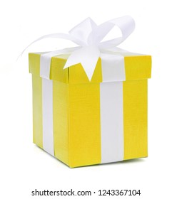 Christmas and New Year's Day , yellow gift box white background, clipping path included.