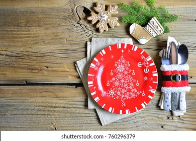 Christmas and New Year's service with a plate and decorations, copy space
