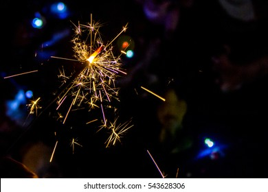 Christmas and newyear party sparkler isolated on black background. Bengal fire firework