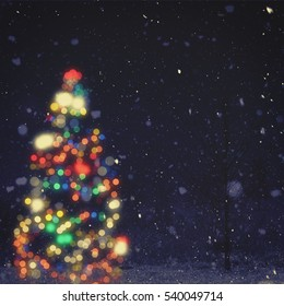 Christmas night, blurred noel backgrounds with decorations light, beauty bokeh and snowfall