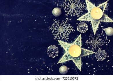 christmas night dark card, new year decoration, star, candles, snowflakes, cones, balls, toned effect