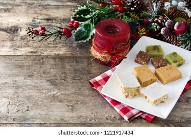 Christmas nougat on wooden table. Copyspace