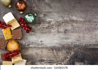 Christmas nougat and spanish polvorones on wooden background.