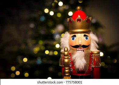 Christmas nutcracker with Christmas tree in background
