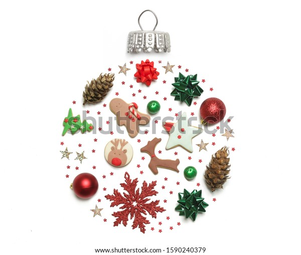 Christmas objects laid out in the shape of a Christmas bauble isolated on white background, top view. Christmas, winter holiday, new year concept.