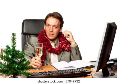 Christmas in the office. Businessman with champagne glass over white background