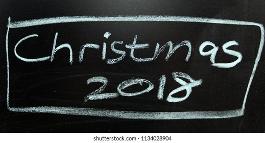 Christmas, on a blackboard with chalk.