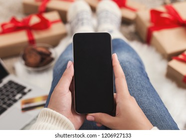 Christmas online shopping in app. Female buyer making order on smartphone, copy space