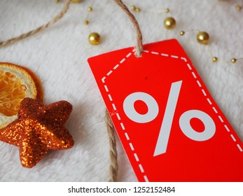 Christmas orange star with discount label on festive background