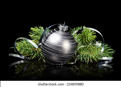 Christmas ornament with fir on a black background