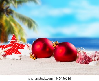 Christmas ornament on a beach,concept of a warm, tropical weather Christmas