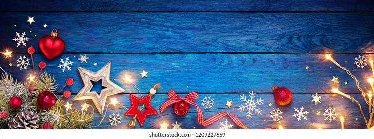 Christmas Ornament On Blue Table With String Light