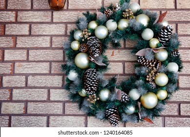 Christmas ornament on brick wall