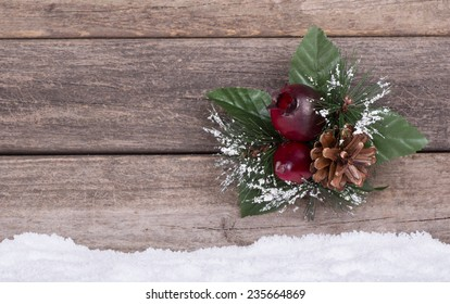 Christmas ornament on a rustic wooden background with snow