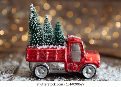 Christmas ornament on wooden background with bokeh lights
