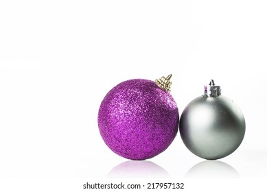 Christmas Ornament silver and purple on white background.