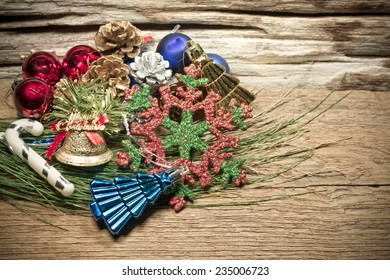 Christmas ornament and vary of decoration on wood background.