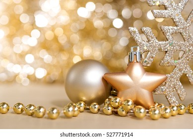 Christmas ornaments with abstract gold circle bokeh light sparkle background with copy space, Greeting card for christmas and happy new year seasonal