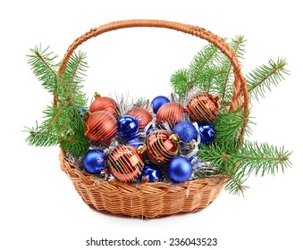 Christmas ornaments in a basket isolated on white background