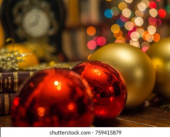 Christmas ornaments, bauble and clock over the background with  bookcase of plenty of books. Xmas