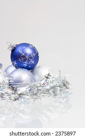 Christmas ornaments in blue and white colors