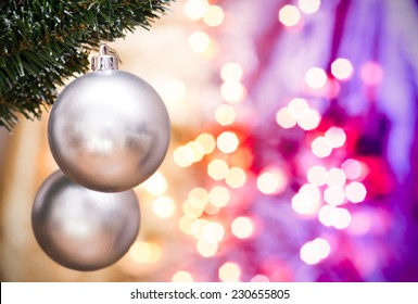 Christmas ornaments with blurred golden, purple background