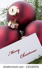 Christmas Ornaments with card and words 'Merry Christmas'