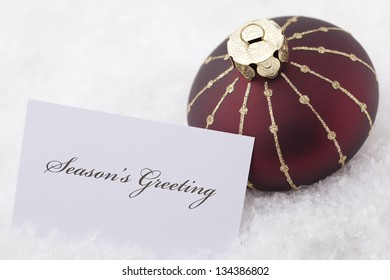 Christmas Ornaments with card and words 'season's greeting'