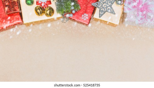 Christmas ornaments decorations on plank wood with snow for texture and background, Border design.