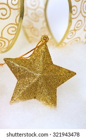 Christmas ornaments: golden five-pointed star with golden ribbon