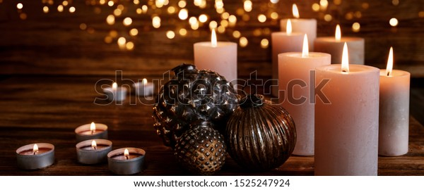 Christmas ornaments on old rustic wood with festive golden lights