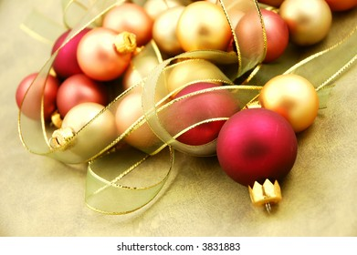 Christmas ornaments on paper surrounded by ribbon