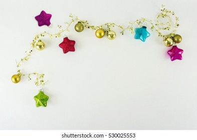 Christmas ornaments on a white background with space for copy.