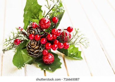 Christmas ornaments on white wooden background
