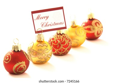 "Christmas ornaments, one with message ""Merry Christmas"", copyspace, shallow DOF"