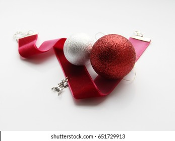 Christmas ornaments and red velvet ribbon with a reindeer pendant
