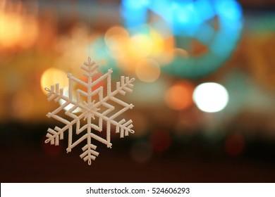 Christmas ornaments snowflake background blur city