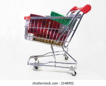 Christmas packages in a miniature shopping cart.