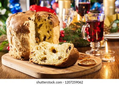 Christmas panettone cake with raisins and fruits. Traditional Italian dish