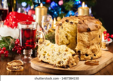 Christmas panettone cake with raisins and fruits. Traditional Italian dish