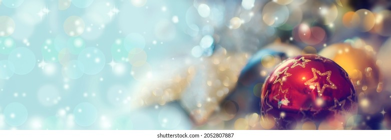 Christmas panoramic background with balls, snowflakes and bokeh.