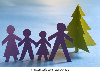 Christmas paper tree and family abstract unique concept